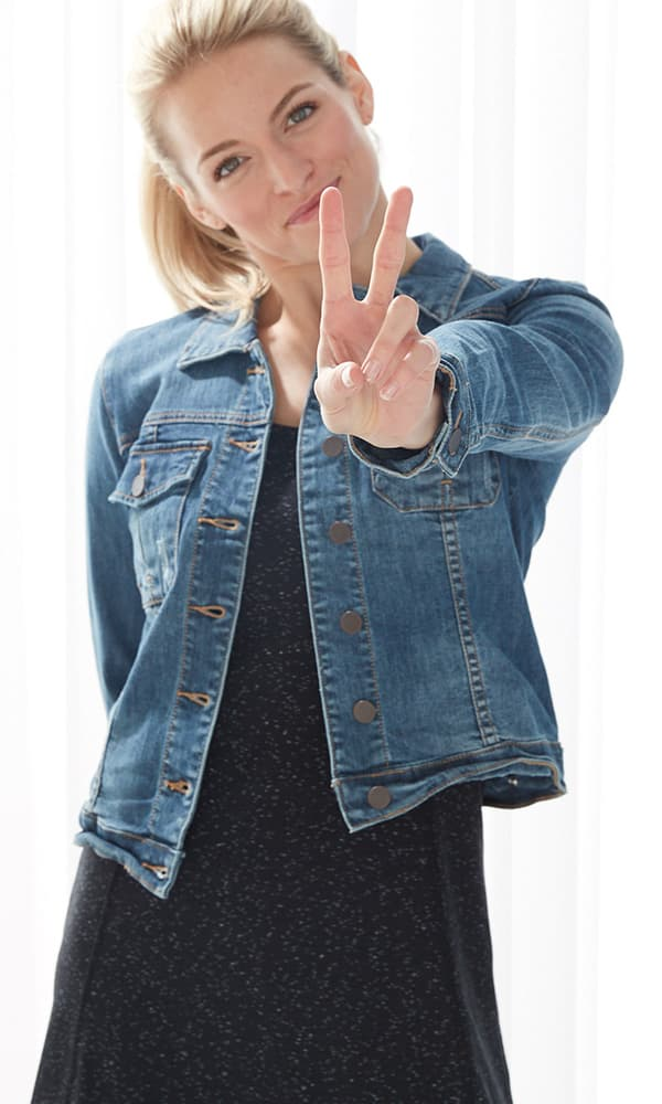 Woman wearing the Tank Dress with a denim jacket